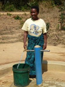 Blandina Mpwepwa fetching water from a new water point in Ihomasa