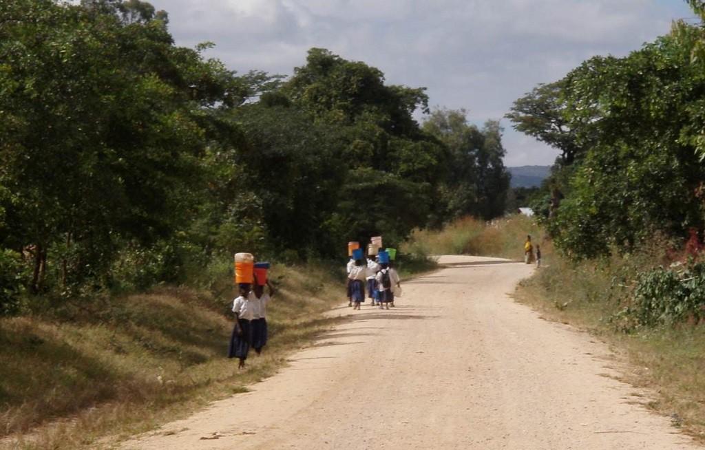Children carrying water