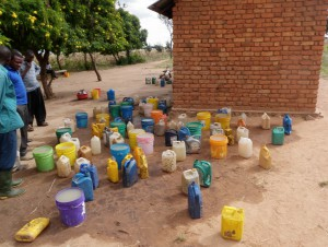 Water collected by children for their porridge at lunchtime