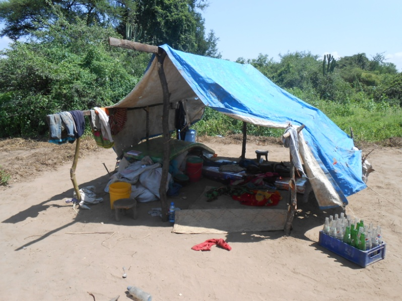 People in Kisanga are living in temporary shelters until they can rebuild their homes