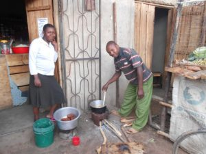 A customer using the portable clay stove