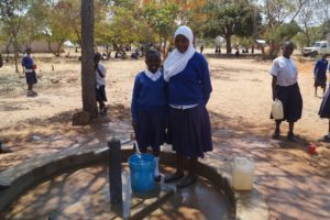 Kids fetching water at Kiwere primary school